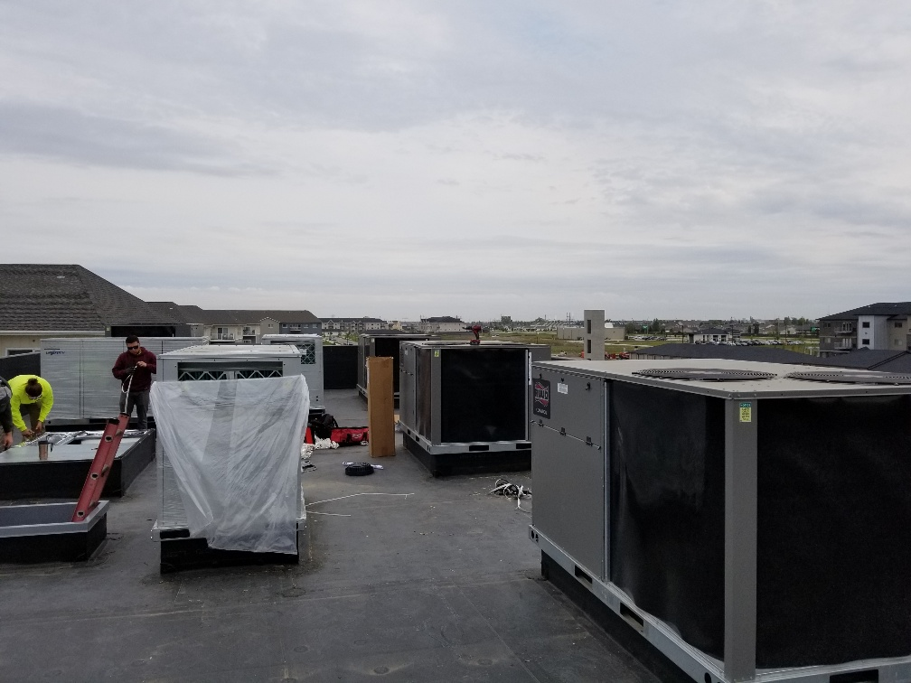 air mechanical installing hvac units on roof